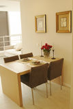 Dinnertable with chairs. Timber dinnertable with chairs and dinnerware stock photography