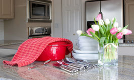 Dinnertime - casserole, plates in modern kitchen Royalty Free Stock Photos