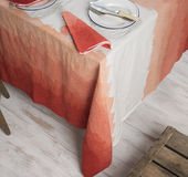 Dinnerware and Napkin on Table Covered in Gradient Orange Zigzag Royalty Free Stock Photos