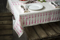 Dinnerware Sets Arranged on Table Laid with Fork-Patterned Table Royalty Free Stock Images