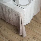 Dinnerware on Table Covered in Linen with Light Brown Zigzag Des Royalty Free Stock Photo