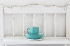 Dinnerware on white wooden shelf Royalty Free Stock Photo
