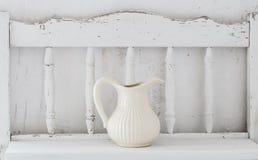 Dinnerware on  wooden shelf Royalty Free Stock Photography