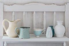 Dinnerware on wooden shelf Stock Photography