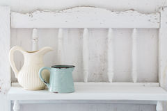 Dinnerware on  wooden shelf Royalty Free Stock Images