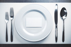 Dinnerwear with white card. Top view of dinnerwear with empty white business card. Mock up, 3D Rendering Stock Image
