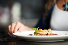Woman dinning at restaurant Stock Photos