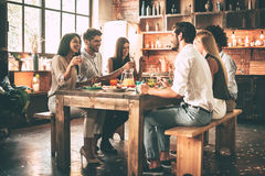 Dinning with best friends. Stock Image