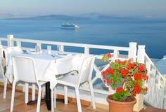 Dinning in a greek romantic restaurant. Dinning table in Santorini, Greece Stock Photo