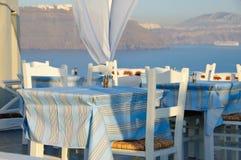 Dinning in a greek romantic restaurant. Dinning table in Santorini, Greece Stock Photos