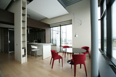 Dinning room. Modern dinning room with red chairs Royalty Free Stock Image