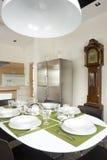 Dinning room. With old pendulum clock Royalty Free Stock Photos