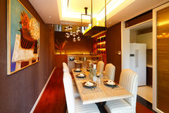 Dinning room. The luxury dinning room in a modern house royalty free stock image