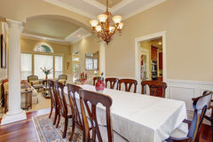 Dinning room with large table and lots of chairs. Stock Photography