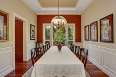 Dinning room with large table and lots of chairs. Royalty Free Stock Image