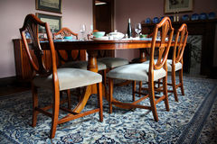 Dinning room table. And chairs stock image