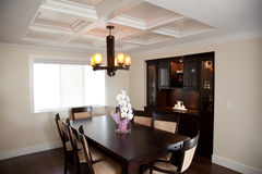 Dinning room with wood table and wood cabinets Stock Photos