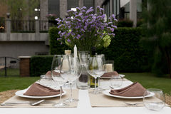Dinning table in the garden Royalty Free Stock Images