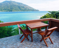 Dinning table at resort. Near the sea on the island against clear sky on holiday Stock Images