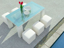 Dinning table beside swimming pool. Stock Photos