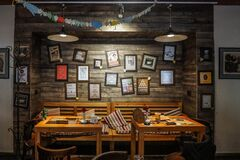 Dinning Tables Near Wall With Photo Frame Decor Royalty Free Stock Images