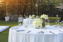 Dinning wedding table set with white lotus stock images