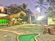 Dino land. The dino land park with mini golf Royalty Free Stock Images