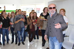 Dino Merlin. TUZLA, BOSNIA AND HERZEGOVINA, APRIL 18. Dino Merlin greets fans at the M-TEL Building to sign CDs HIT for fans on April, 18, 2011 in Tuzla, Bosnia Royalty Free Stock Photos