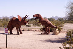 Dino Rest Area. A Pet Area at a truck stop featuring a triceratops type versus a t-rex type dinosaur Royalty Free Stock Photo