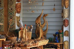 Dinos and masks. The range of souvenir woodcarver's shop in Hersonissos. Crete, Greece Royalty Free Stock Images