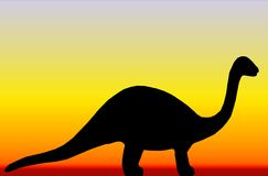 Dinosaur. A dinosaur against a sunset background Royalty Free Stock Photography