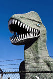 Dinosaur behind fence. Royalty Free Stock Images