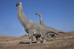 Dinosaur. Brachiosaurus. Prehistoric accurate Horsetail carboniferous trees stock photo