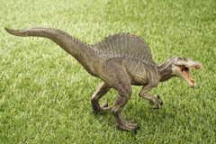 Dinosaur. Close up Isolated dinosaur on grass background royalty free stock photography