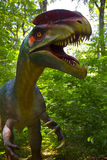 Dinosaur. Closeup of a natural size dinosaur in the forest at Dino Parc Rasnov, Romania Stock Image