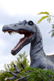 Dinosaur coming out of the forest. Huge dinosaur coming out of the forest royalty free stock image