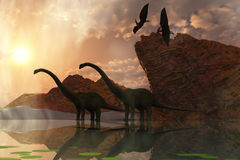 Dinosaur Dawn. Two diplodocus dinosaurs and two flying pterodactyl birds greet the early morning mist Stock Images