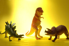 Dinosaur Diversity. Plastic dinosaur toys: Tyrannosaurus rex, Stegasaurus, and Triceratops. Seniors are often referred to as dinosaurs Royalty Free Stock Photos