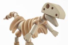 Dinosaur drewniana przegubna zabawka odizolowywająca na bielu Obrazy Royalty Free