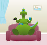 Dinosaur drinking tea at home. Good dinosaur drinking tea with cookies at home Stock Photos