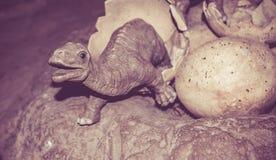 Dinosaur and eggs. Dinosaur sculpture, huge animal model for learn stock photo