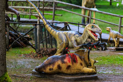 Dinosaur exhibition in botanic park. VOLCJI POTOK, SLOVENIA - April 6th 20014: Dinosaur exhibition in botanic park Arboretum in Volcji Potok, Slovenia, attracts Royalty Free Stock Photos