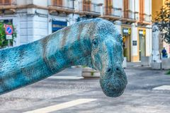 Dinosaur featured in an exhibition held in Cosenza, Italy. COSENZA, ITALY - AUGUST 25: Dinosaur featured in the open air exhibition held in Cosenza, Italy royalty free stock photography