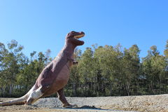 Dinosaur in field Royalty Free Stock Photo