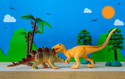 Dinosaur fight scene. On wild models background Royalty Free Stock Photo