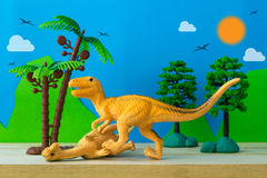 Dinosaur fight scene on wild models background. Closeup Stock Images