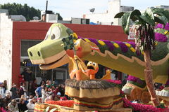 Dinosaur Float. Rose Parade float with a big green dinosaur Stock Image