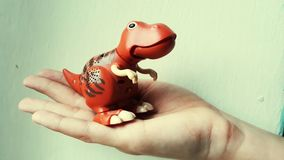Dinosaur in hand stock photo