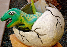 Dinosaur hatching. Out of egg Royalty Free Stock Images