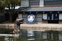 Dinosaur infront of Historic Building at Toei Kyoto Studio Park Royalty Free Stock Image